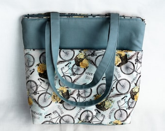 Blue padded tote bag with vintage bicycles