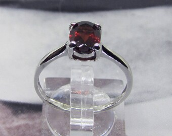 Topped with a Garnet Facettee size 52 stone silver ring