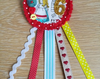 Birthday badge rosette in Alice in Wonderland fabric for a 6th birthday