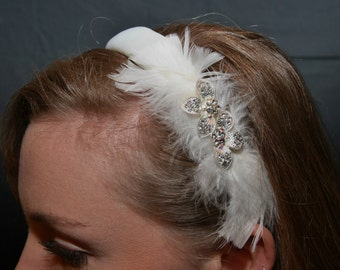 White bridal headband with feathers and rhinestones