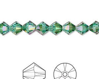 NEW Swarovski® Crystal Passions® Light Turquoise Luminous Green Faceted Bicone Crystals 6mm 12 pcs 5328