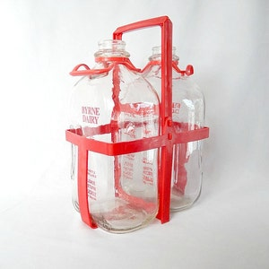 vintage glass milk bottles, red plastic carrier,  BYRNE DAIRY, half gallon milk bottles