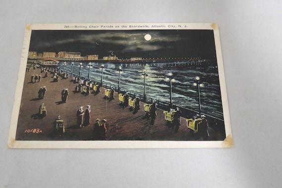 vintage atlantic city boardwalk rolling chair parade night