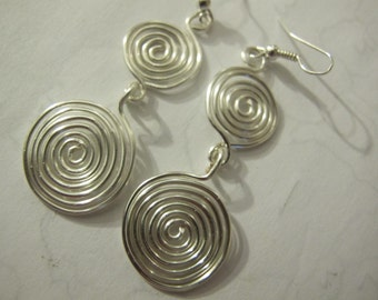 Silver wire wrapped double spiral dangle earrings