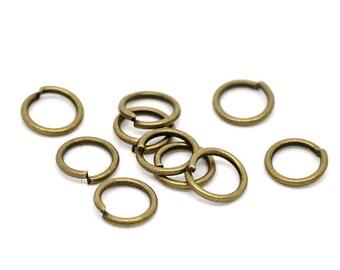 Jump Rings : 100 Antique Bronze 7mm Jump Rings | Brass Ox Open Jump Rings 7mm x .9mm (19 Gauge) -- Lead, Nickel, & Cadmium free .9-7