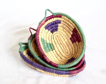 Vintage wicker baskets with hangers…wickers bowls or trays...colorful raffia baskets, bowls, trays...farmhouse chic.