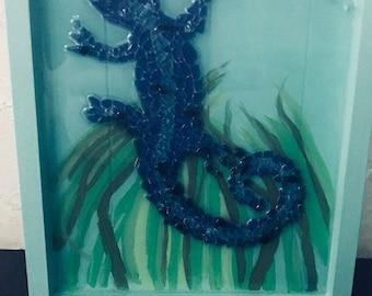 Cobalt blue glass art lizard on wood canvas