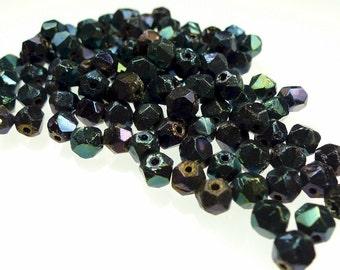 Rough cut, glass beads jet metallic blue coating size 6mm