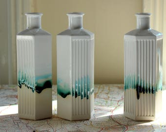Poison bottle bud vase. Stem vase. Green or white ceramic vase is modern home decor or unique ornament, kitchen decor or interior design.
