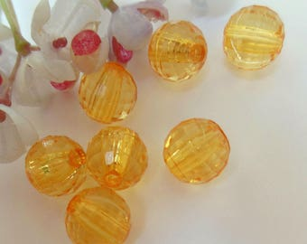 Yellow set of 7 faceted plastic beads