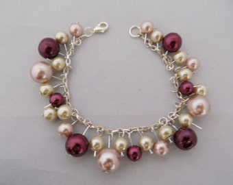 Pink, cream, and red pearls charm bracelet