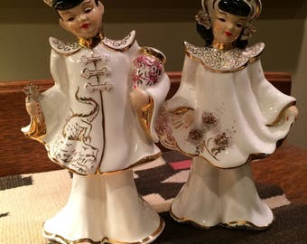 Pair of Ceramic Figurines - Asian Man and Woman in Cream and Gold