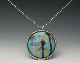 Enamel Pendant No. 4 - vitreous enamel with gold leaf on copper dome set in silver