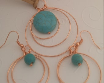 Copper and turquoise hoops set with tan