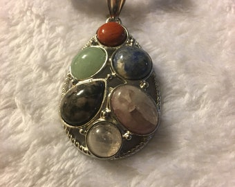 Varying in color stone pendant