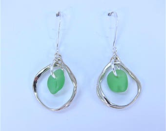 SeaCycled Earrings with green sea glass from Cape Breton, Nova Scotia circled in sterling silver on a nickle-free hook