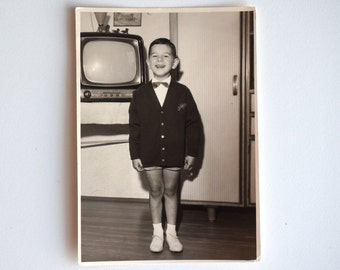 Genuine old photo smiling boy and television, vintage photograph 1960s from Italy