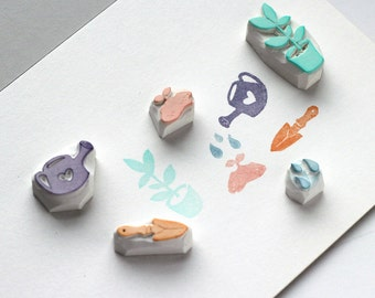 Gardening rubber stamp. Hand carved rubber stamp. Set of garden trowel, watering can, sprout, water drops, and flowerpot. Or choose.