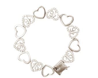 Sterling Silver Sweet 16 Dancing Hearts Bracelet (Free Shipping)