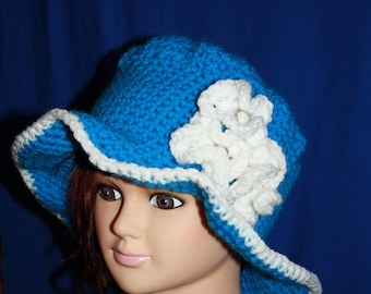 Hat with large blue rim with white flowers