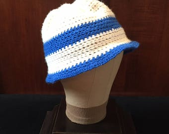 Crocheted white hat with blue trim