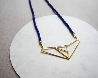 24ct gold vermeil wire geometric pendant on fine cobalt blue glass beads