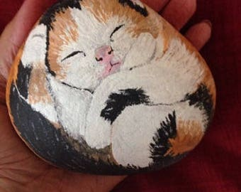 sleeping kitten handpainted stone