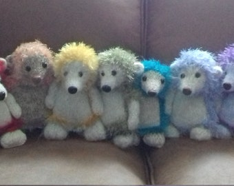Knitted rainbow hedgys