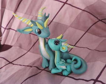 Mother with baby polymer clay dragon