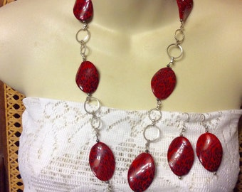Vintage 1980's red acrylic disc animal print necklace and earrings set.