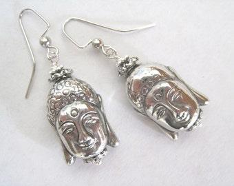 Serenity. Metallic Silver Buddha dangle earrings. Lightweight.