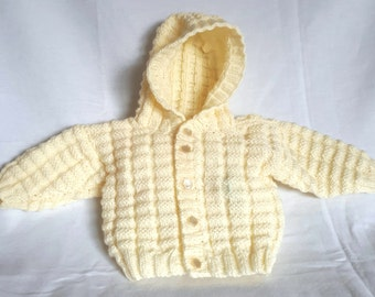 Beautifully hand knitted hooded cardigan