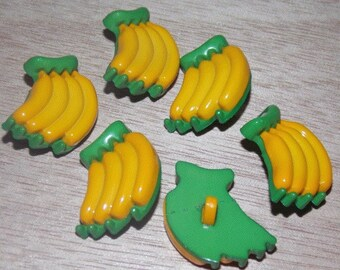 Set of six buttons plastic with foot banana