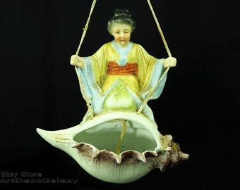 Antique German Bisque Japanese Girl Swinging on a Shell