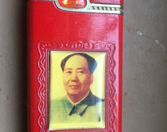 MAO TSE TUNG lighter - non functional. Don't know era. Cute.  2 nicks.  Red.  I heard they play a song.  Mao.