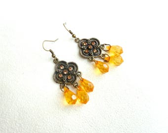 Rosette earrings in bronze and faceted beads