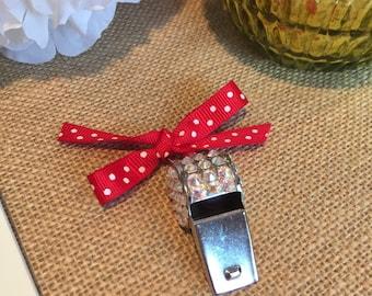 Red & white polka dot ribboned blinged whistle.