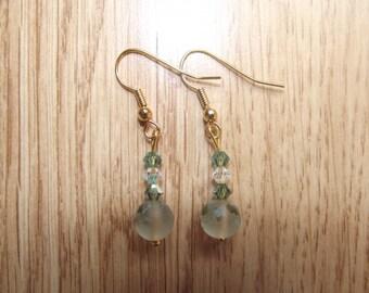 Green swarovski stud earrings.