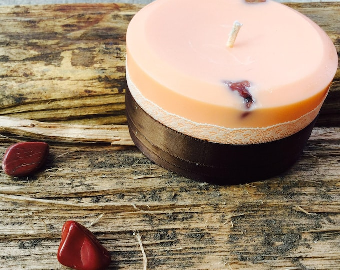 Fertility Spell Candle made w/natural soy and embedded w/Red Aventurine. A perfect altar candle. Sandalwood scented