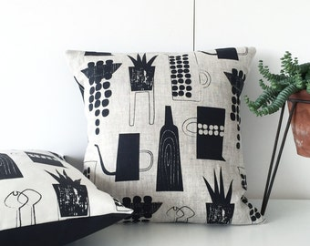 Botanics and ceramics cushion on natural linen