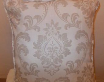 Jacquard cotton weave cushion covers in Cream, with a piped edging.