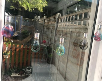 Solar powered marble string lights