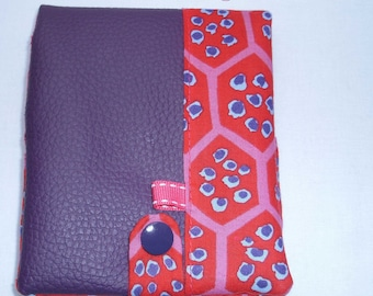 Notebook 8.5 cm by 12 cm, with its purple leatherette cover