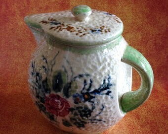 Vintage textured teapot with concave handle area made in Japan
