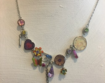 Multi component charm, dangle necklace butterfly, flowers, and hearts dangle