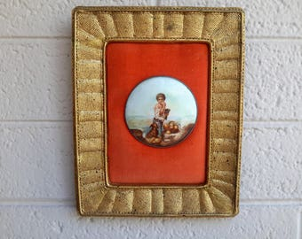 Italian Framed Painted Porcelain Medallion Boy and Dog Gold Florentine Style Orange Background Fine Home Decor