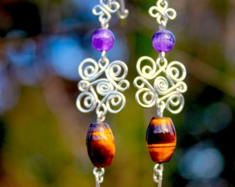 Hand made earrings with hammered wire, tiger eye, and amethyst beads