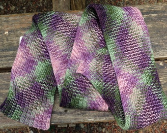 Hand knitted scarf OOAK, 56 inch long and 4 inch wide,  Blue Moon super wash merino pinks, purples and green
