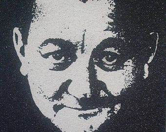 """Coluche"" sand painting in natural sand"