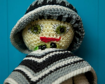 Adorable Crochet Doll with poncho, hat and small necklace